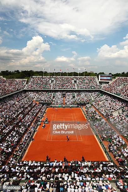 Nick Kyrgios of Australia serves during the Men's Singles third round match against Richard Gasquet of France on day six of the 2016 French Open at...