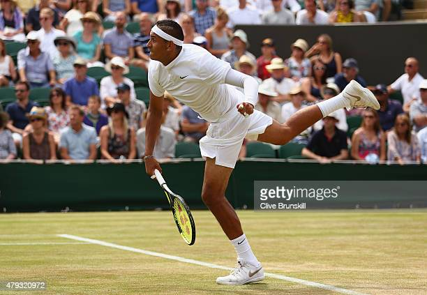 Nick Kyrgios of Australia serves in his Gentlemen's Singles Third Round match against Milos Raonic of Canada during day five of the Wimbledon Lawn...