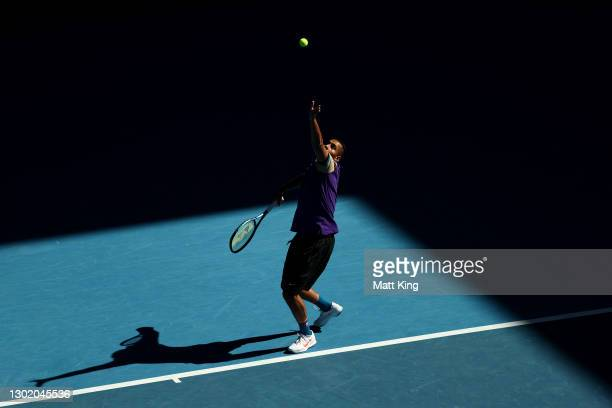 Nick Kyrgios of Australia serves in his Men's Doubles second round match with partner Thanasi Kokkinakis of Australia against Wesley Koolhof of the...