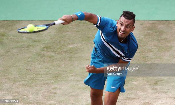 Nick Kyrgios of Australia serves the ball to Roger Federer of Switzerland during day 6 of the Mercedes Cup at Tennisclub Weissenhof on June 16 2018...