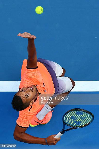 Nick Kyrgios of Australia serves to Jack Sock of the United States during the men's singles match on day five of the 2017 Hopman Cup at Perth Arena...
