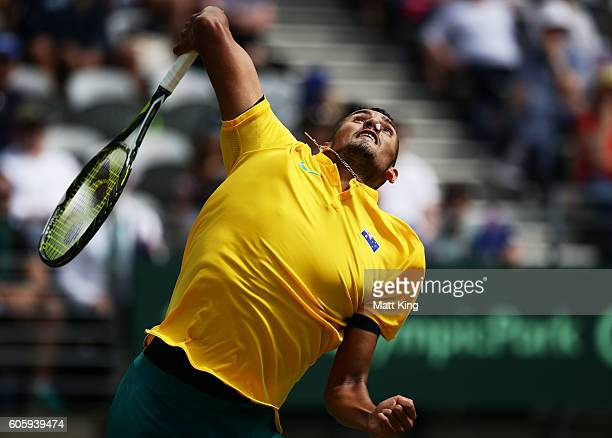 Nick Kyrgios of Australia serves with his nose plugged due to a nose bleed in his singles match against Andrej Martin of Slovakia during the Davis...