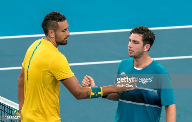 Nick Kyrgios of Australia shakes hand with Cameron Norrie of Great Britain after winning their quarter final singles match during day seven of the...