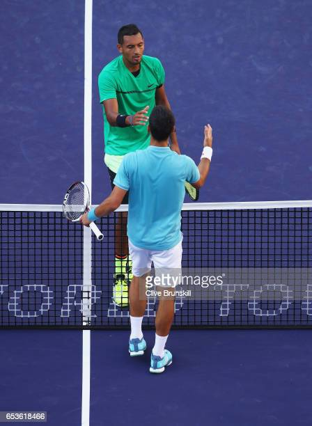 Nick Kyrgios of Australia shakes hands at the net after his straight set victory against Novak Djokovic of Serbia in their fourth round match during...