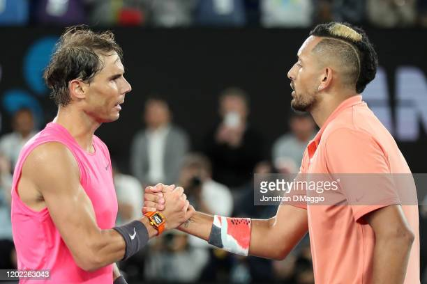 Nick Kyrgios of Australia shakes hands with Rafael Nadal of Spain at the net following their Men's Singles fourth round match on day eight of the...
