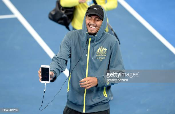 Nick Kyrgios of Australia shares a laugh with team mates during practice ahead of the Davis Cup World Group Quarterfinal match between Australia and...