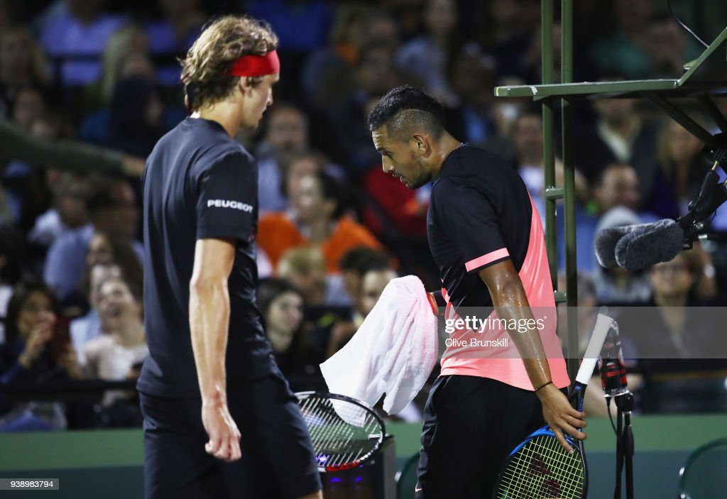 Nick Kyrgios of Australia shows his dejection as he walks past Alexander Zverev of Germany in their fourth round match during the Miami Open Presented by Itau at Crandon Park Tennis Center on March 27, 2018 in Key Biscayne, Florida.