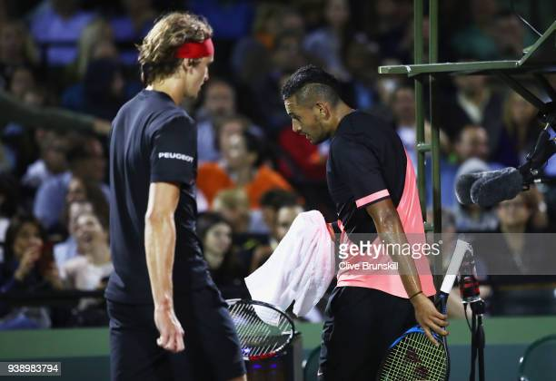 Nick Kyrgios of Australia shows his dejection as he walks past Alexander Zverev of Germany in their fourth round match during the Miami Open...