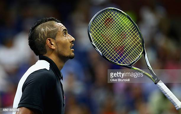 Nick Kyrgios of Australia shows his emotions as he throws his racket during his first round match against Andy Murray of Great Britain on Day Two of...