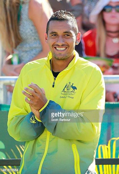 Nick Kyrgios of Australia shows his support during the reverse singles match between Lleyton Hewitt of Australia and Aleksandr Nedovyesov of...