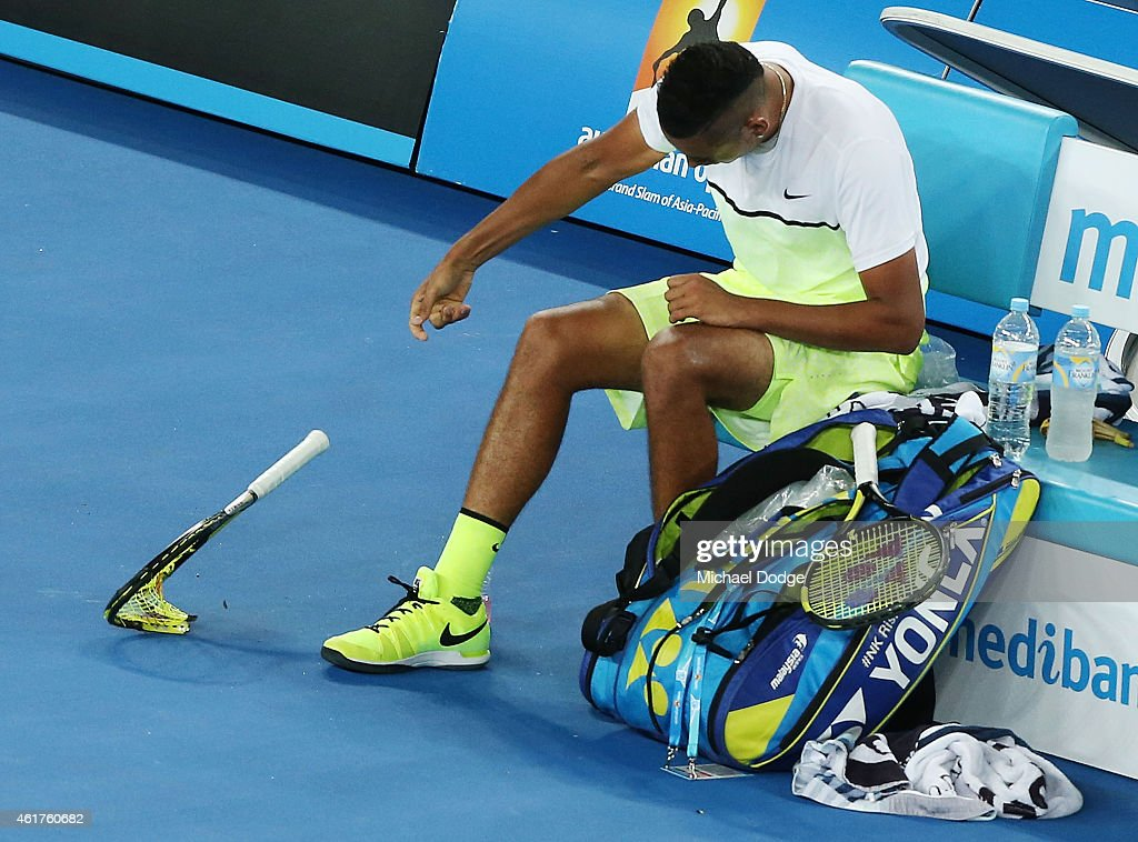 Nick Kyrgios of Australia smashes his racquet after losing a game in his first round match against Frederico Delbonis of Argentina during day one of the 2015 Australian Open at Melbourne Park on January 19, 2015 in Melbourne, Australia.