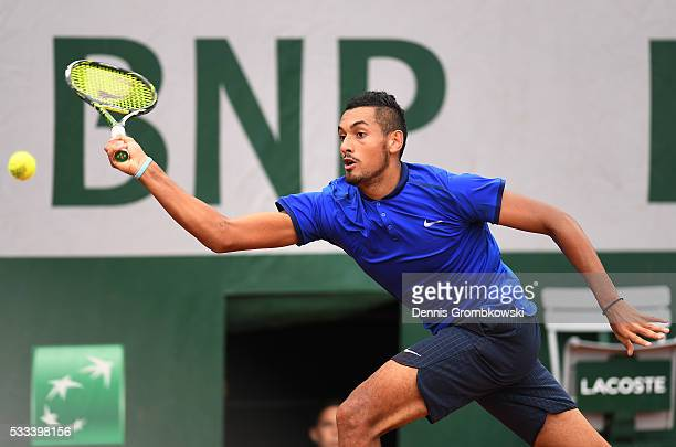 Nick Kyrgios of Australia stretches for a forehand during the Mens Singles first round match against Marco Cecchinato of Italy on day one of the 2016...