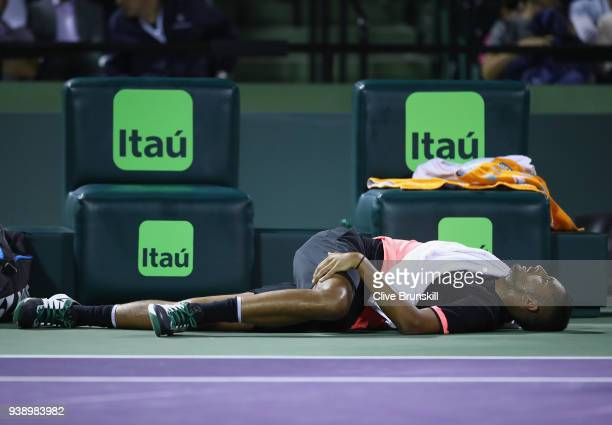 Nick Kyrgios of Australia stretches in the change over as he complained of a sore back against Alexander Zverev of Germany in their fourth round...
