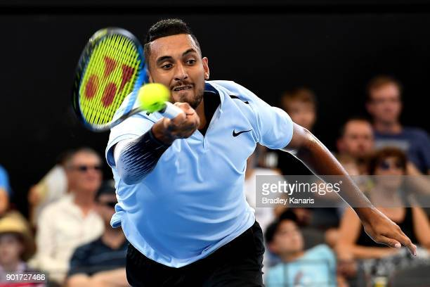 Nick Kyrgios of Australia stretches out to play a forehand in his semi final match against Grigor Dimitrov of Bulgaria during day seven of the 2018...