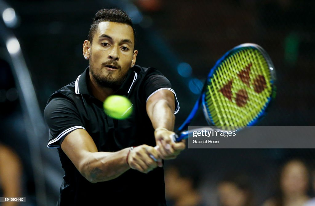 Nick Kyrgios of Australia takes a backhand shot during an exhibition match between Juan Martin Del Potro and Nick Kyrgios at Luna Park on December 15, 2017 in Buenos Aires, Argentina.