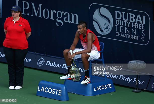 Nick Kyrgios of Australia takes a rest on a line judges chair during his quarter final match against Tomas Berdych of Czech Republic on day six of...