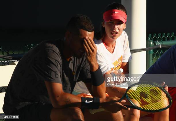 Nick Kyrgios of Australia talks with Ajla Tomljanovic of Australia during a practice session on day two of the BNP Paribas Open at Indian Wells...