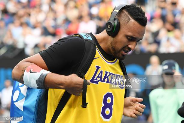 Nick Kyrgios of Australia tears up as he walks onto Rod Laver Arena wearing a number 8 Kobe Bryant Jersey ahead of his Men's Singles fourth round...