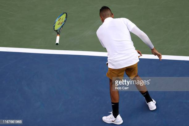 Nick Kyrgios of Australia throws his racket against Lorenzo Sonego of Italy during Day 3 of the Western and Southern Open at Lindner Family Tennis...