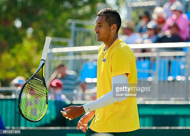 Nick Kyrgios of Australia throws his racquet as he loses a game against Aleksandr Nedovyesov of Kazakhstan during day one of the Davis Cup World...