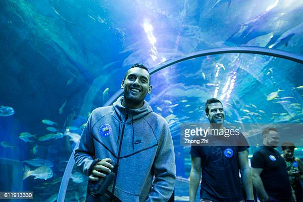 Nick Kyrgios of Australia visits Cube Oceanarium on Day 6 of 2016 ATP Chengdu Open at Sichuan International Tennis Centre on October 1 2016 in...