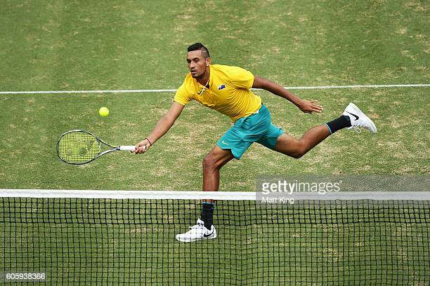 Nick Kyrgios of Australia volleys in his singles match against Andrej Martin of Slovakia during the Davis Cup World Group playoff between Australia...