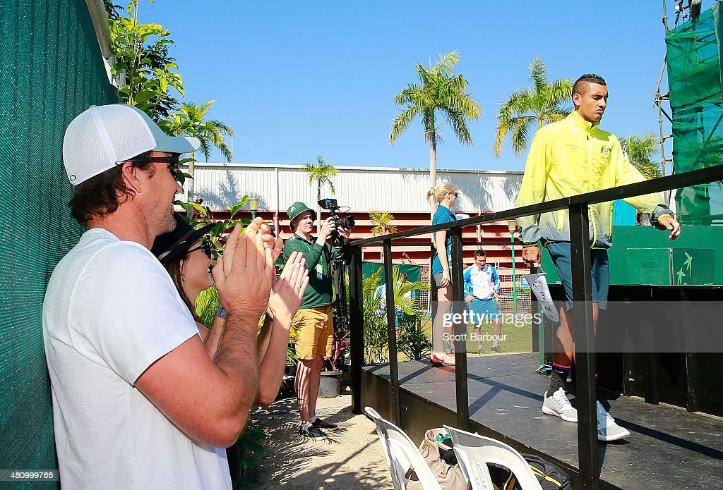 Nick Kyrgios (R) of Australia walks past Pat Rafter (L) as he makes his way onto the court for the opening ceremony during day one of the Davis Cup World Group quarterfinal tie between Australia and Kazakhstan at Marrara Sporting Complex on July 17, 2015 in Darwin, Australia.