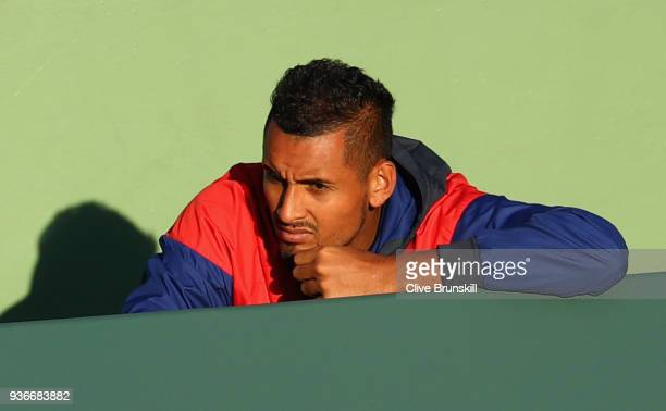 Nick Kyrgios of Australia watches girlfriend Ajla Tomljanovic of Australia in action against Sloane Stephens of the United States in their second...