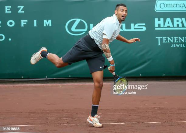 Nick Kyrgios of Australia watches his serve in the match against Ivo Karlovic of Croatia during the Quarterfinal round of the Men's Clay Court...