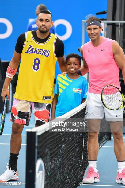 Nick Kyrgios of Australia wears a Lakers shirt in memory of Kobe Bryant before his fourth round match against Rafael Nadal of Spain on day eight of...