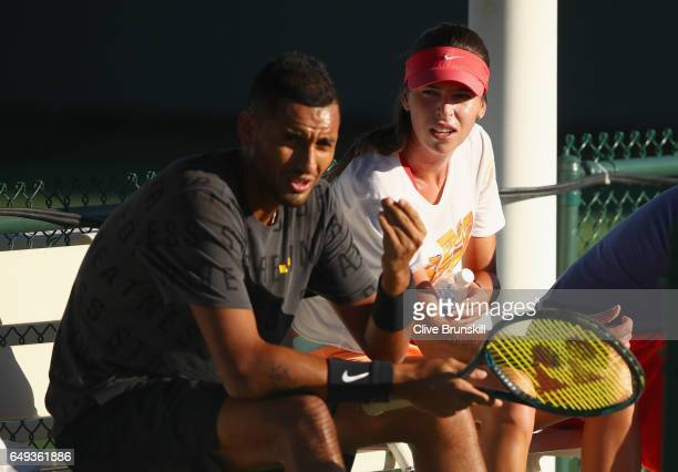 Nick Kyrgios of Australia with Ajla Tomljanovic of Australia during a practice session on day two of the BNP Paribas Open at Indian Wells Tennis...