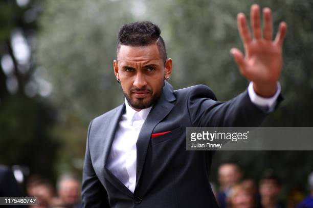 Nick Kyrgios of Team World acknowledges the fans as he arrives at Palais Eynard for the official welcome ceremony prior to the Laver Cup 2019 at...