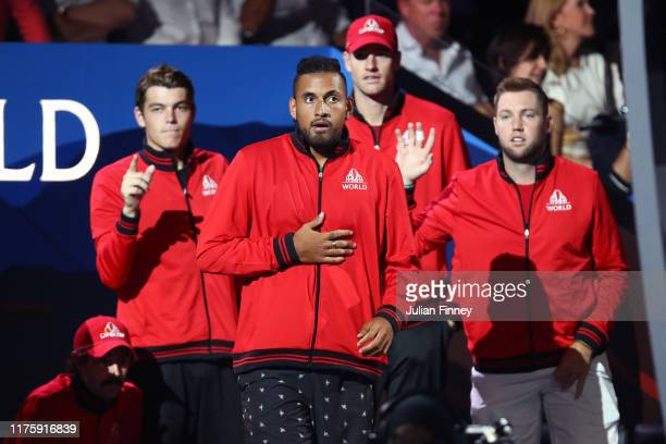 Nick Kyrgios of Team World and teammates react as they watch the singles match between Dominic Thiem of Team Europe and Denis Shapovalov of Team...