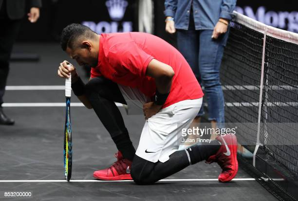 Nick Kyrgios of Team World joined NFL stars from Wembley by dropping his knee before his Laver Cup match with Roger Federer today during his mens...