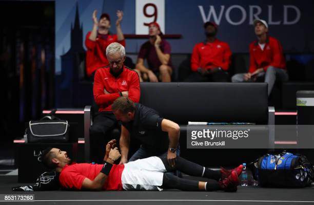 Nick Kyrgios of Team World lies injured during his mens singles match against Roger Federer of Team Europe on the final day of the Laver cup on...