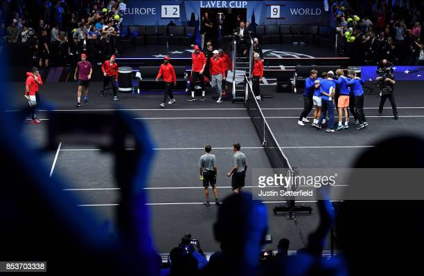 Nick Kyrgios of Team World looks dejected as Team Europe celebrate after Roger Federer of Team Europe wins the Laver Cup on match point during his...