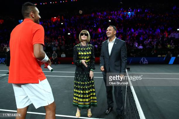 Nick Kyrgios of Team World looks on as Anna Wintour Editorinchief of Vogue and Artistic Director of Conde Nast performs the coin toss ahead of the...