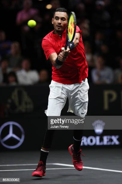 Nick Kyrgios of Team World plays a backhand during his mens singles match against Roger Federer of Team Europe on the final day of the Laver cup on...