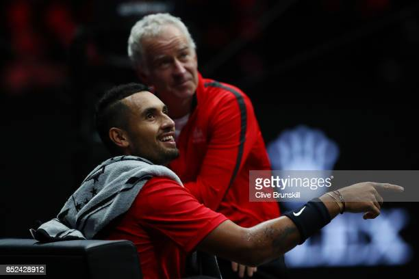 Nick Kyrgios of Team World talks with John Mcenroe Captain of Team World during his singles match against Tomas Berdych of Team Europe on Day 2 of...