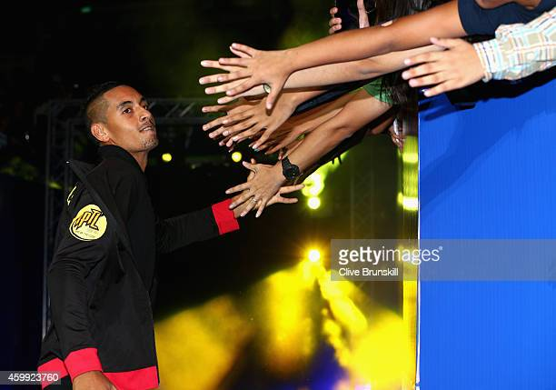 Nick Kyrgios of the Singapore Slammers high fives the fans as he runs out for his teams match against the UAE Royals during the Coca-Cola...