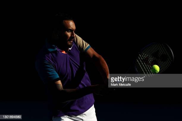 Nick Kyrgios plays a backhand in his Men's Doubles second round match with partner Thanasi Kokkinakis of Australia against Lloyd Harris of South...