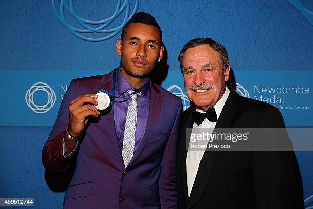 Nick Kyrgios poses for photos with John Newcombe after winning the Newcombe Medal at the 2014 Newcombe Medal Awards at Crown Palladium on November 24...