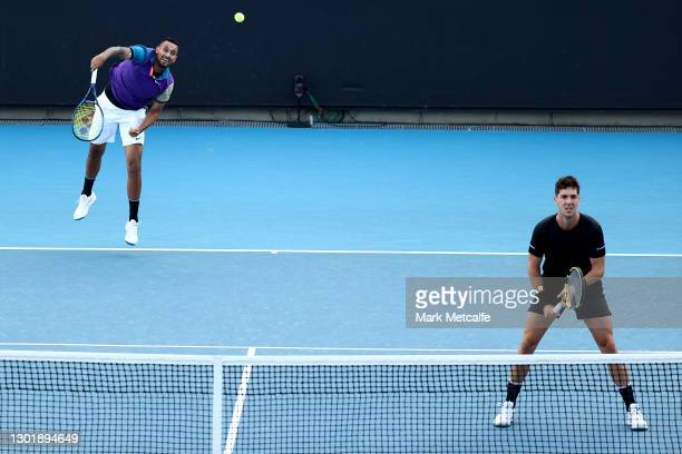 Nick Kyrgios serves in his Men's Doubles second round match with partner Thanasi Kokkinakis of Australia against Lloyd Harris of South Africa and...