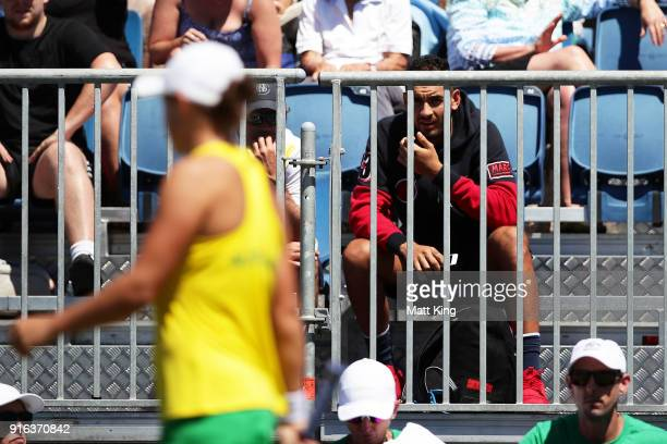 Nick Kyrgios watches the singles match between Ashleigh Barty of Australia and Lyudmyla Kichenok of Ukraine during the Fed Cup tie between Australia...