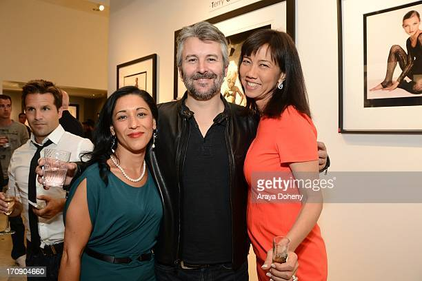 Nick Kyriakou Gavin Lurssen and Keiko Noah attend a gallery exhibit of Terry O'Neill Presents The Opus A 50 Year Retrospective at Mouche Gallery on...