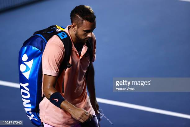 Nick Kyrigios of Australia retires after an injury during the singles match between Nick Kyrigios of Australia and Ugo Humbert of France as part of...