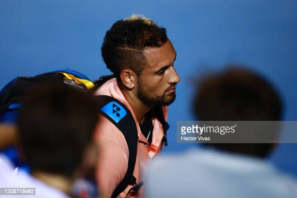 Nick Kyrigios of Australia retires after and injury during the singles match between Nick Kyrigios of Australia and Ugo Humbert of France as part of...