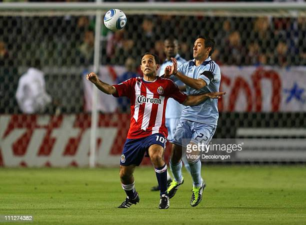 Nick LaBrocca of Chivas USA protects the ball from Davey Arnaud of Sporting Kansas City in the first half during the MLS match at The Home Depot...