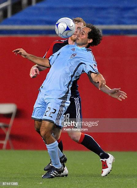 Nick LaBrocca of the Colorado Rapids heads the ball in front of Pat Phelan of the New England Revolution May 16, 2009 at Gillette Stadium in...