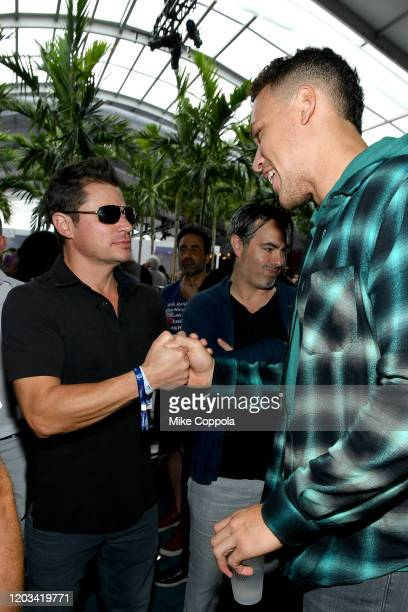 Nick Lachey and Aaron Judge attend Michael Rubin's Fanatics Super Bowl Party at Loews Miami Beach Hotel on February 01 2020 in Miami Beach Florida